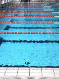 Swimming pool with blue water and the swimming lanes Stock Image