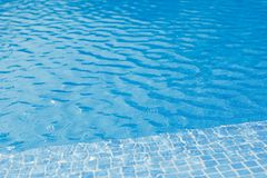 Swimming pool with blue water and tile Stock Photos