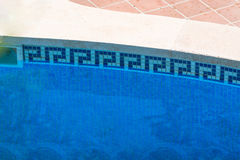 Swimming pool with blue water to relax. Luxury swimming pool with beautiful landscaping of the territory Stock Photo
