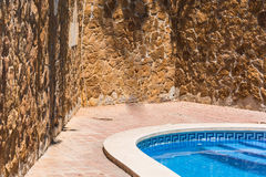 Swimming pool with blue water to relax. Stock Photography