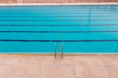 Swimming Pool.swimming pool bottom caustics ripple and flow with waves background.Swimming pool of luxury hotel. Blue water and laens in swimming pool royalty free stock image