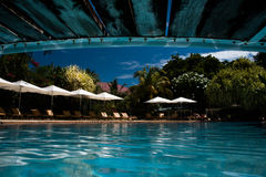 Swimming pool bridge reflection royalty free stock photography