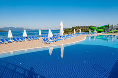 The swimming pool on bright summer day Royalty Free Stock Images