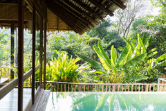Swimming pool and bungalow at hotel resort Stock Images