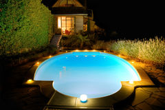 Swimming-pool with candles at night Royalty Free Stock Images