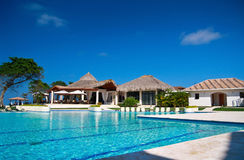 Swimming pool in caribbean resort Stock Photo