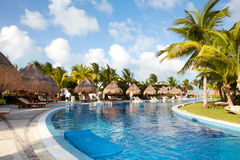 Swimming pool at caribbean resort. Royalty Free Stock Photography