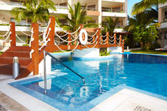 Swimming pool at caribbean resort. Royalty Free Stock Photo