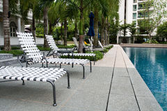 Swimming pool with chairs Royalty Free Stock Image