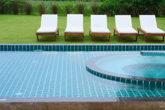 Swimming pool and chairs Royalty Free Stock Photos
