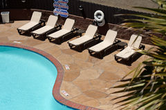 Swimming pool and chairs from above Stock Photography