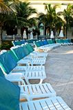 Swimming Pool Chairs And Green Palms Stock Photo