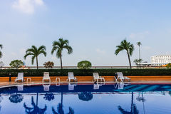 Swimming pool with chairs Royalty Free Stock Images
