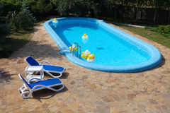 Swimming Pool, chaise-longue, tile Stock Images