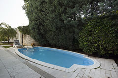 Swimming pool in classic style villa Royalty Free Stock Photo