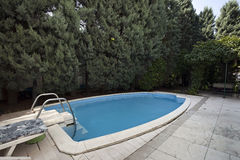 Swimming pool in classic style villa Royalty Free Stock Images