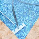 Swimming pool cleaning tools Stock Photo