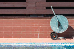 Swimming pool cleaning tools Royalty Free Stock Photography
