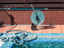 Swimming pool cleaning tools Royalty Free Stock Images