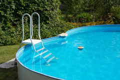 Swimming pool after cleaning. White ladder and summer swimming pool Stock Photo