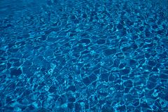 Swimming pool Clear blue water surface with sparkling light reflections. Swimming pool water surface with sparkling light reflections. Clear blue water from a royalty free stock images