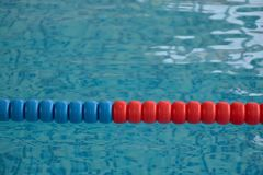 Swimming pool with clear water and swim lanes Stock Photos