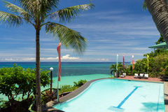 Swimming pool close to the tropical sea with turquoise water Stock Photos