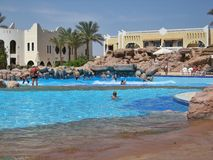 Swimming pool in club el Faraana. The pool with an artificial wave in hotel of Egypt, landscaping, rest in the resort of the Red Sea hit into Naama Bay in Sharm Royalty Free Stock Photo