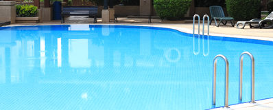 Swimming pool in club house Stock Images