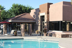 Swimming pool clubhouse. Clubhouse and gated pool at an apartment complex. Taken in Oro Valley in the Sonoran desert of Arizona Stock Photos