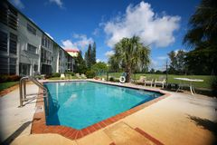 Swimming Pool at Condo on Golf Course Royalty Free Stock Images
