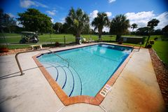 Swimming Pool at Condo on Golf Course Stock Images