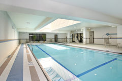 Swimming pool in condominium building Stock Photo