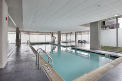 Swimming pool in condominium building Stock Images