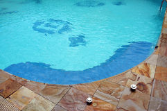 Swimming pool. Corner of the pool with blue water Royalty Free Stock Photography