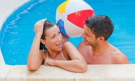Swimming pool couple Stock Images