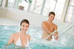 Swimming pool - couple have fun under water stream Stock Images