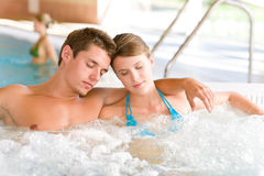 Swimming pool - couple relax in hot tub. Swimming pool - young attractive couple relax in hot tub royalty free stock photography