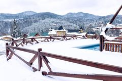 Swimming pool covered with snow near the cottage. Migovo. Ukraine royalty free stock image