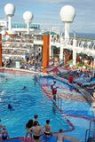 Swimming pool on a cruise ship. Lifeguard watching people in a swimming pool on a Royal Caribbean cruise ship out of Fort Lauderdale, Florida, USA Royalty Free Stock Images