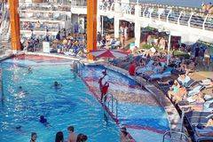 Swimming pool on a cruise ship. Lifeguard watching people in a swimming pool on a Royal Caribbean cruise ship out of Fort Lauderdale, Florida, USA Royalty Free Stock Image
