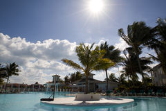 Swimming-pool in cuba. Swimming-pool with palm trees over blue sunny sky Royalty Free Stock Photography