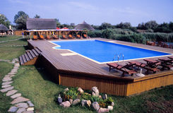Swimming pool and deck. Above ground pool with a large wooden deck