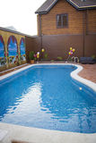 Swimming pool and deck Stock Images