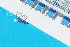 Swimming pool with deck chairs, top view closeup Stock Images