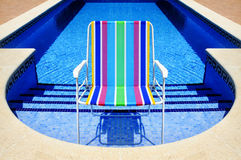Swimming pool and deckchair Royalty Free Stock Photos