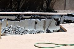 Swimming pool demolition. Empty residential swimming pool under demolition Royalty Free Stock Image