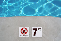 Swimming pool depth marker Royalty Free Stock Photo