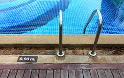 Swimming pool depth marker Stock Images
