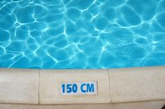 Swimming Pool Depth Safety Sign. A 150cm water depth safety sign at the side of a swimming pool Stock Image